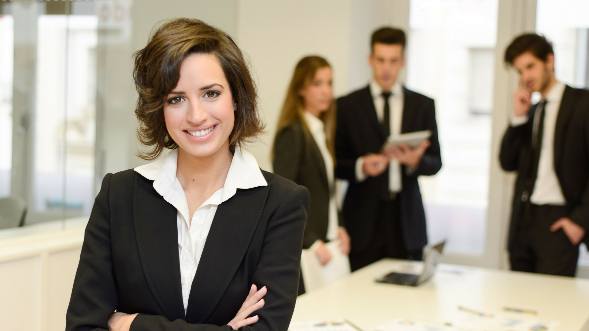smiling executive with crossed arms